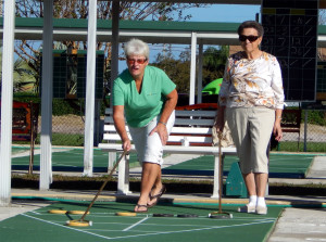women team up and play shuffleboard in Kings Point, Sun City Center, FL