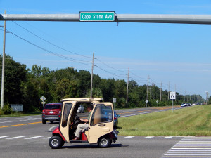 Golf cart crossing over 301 on Cape Stone Ave leaving Walmart