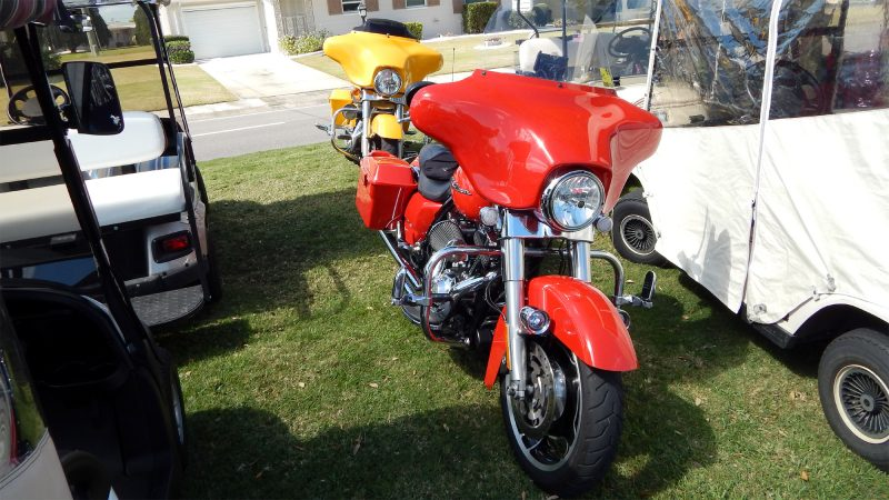 Red and Yellow Street Glide Harley Davidson Motorcycles attend Fun Fest 2014