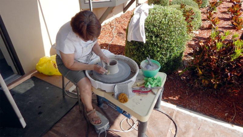 Woman spinning a pot at Potters Wheel Club Sun City Center