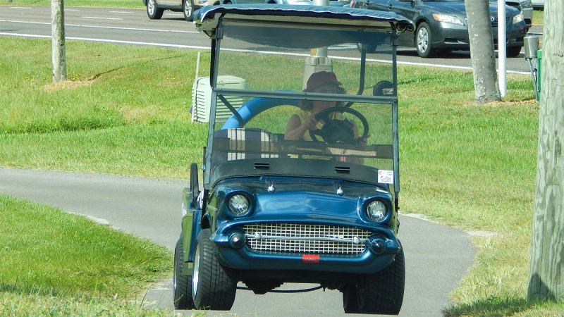 57 Chevy Bel Air golf cart driving on golf cart path to Winn Dixie ...