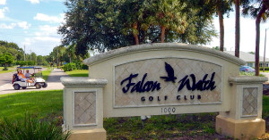 Falcon Watch Golf Club sign with golf cart