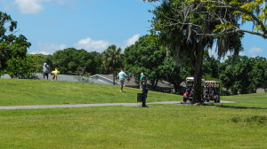 Golfers on Falcan Watch Golf Course carrying drivers