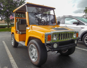Yellow H3 Hummer golf cart