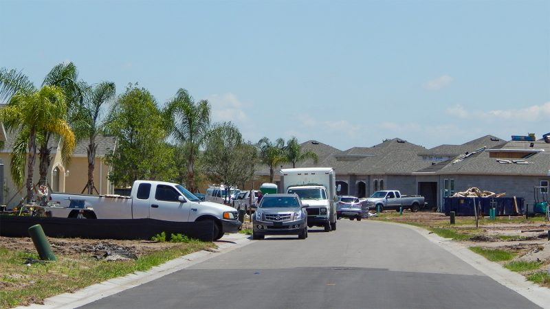 Construction crews close to finishing new homes on Emerald Dunes Drive in Renaissance neighborhood of Sun City Center, FL