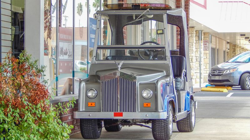 Royal Ride (Rolls Royce) golf cart on sidewalk in Sun City Center Plaza