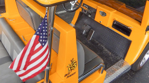 U.S. Flag, BEE HAPPY sticker and dash board of Hummer H3 yellow golf cart, Sun City Center