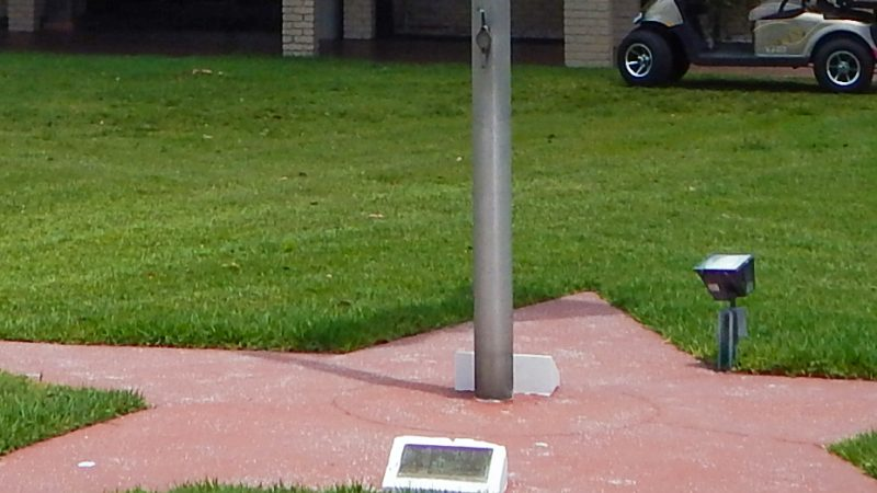 Base of flag with time capsule at North Campus in Sun City Center Association