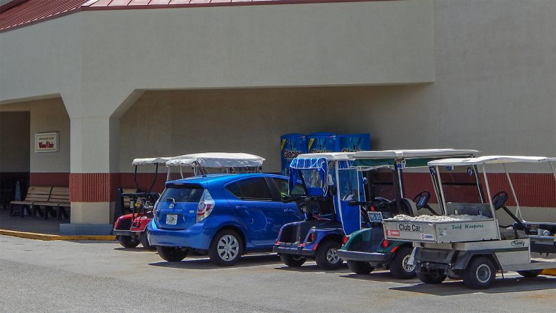 Car squeezes into golf cart parking spot in Sun City Center