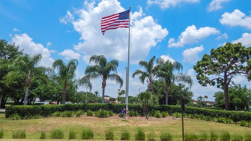 Flag flying on Memorial Day 2014 with flowered reef from Sun City Center Funeral Home