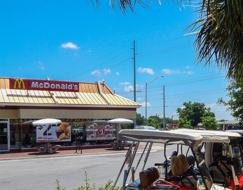 Golf carts drive to McDonald's for lunch time in Sun City Center, FL