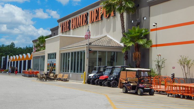 Man loading sheets of wood at The Home Depot in Sun City Center, FL