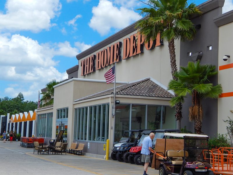 Man loading wood on golf cart at The Home Depot, Sun City Center, FL