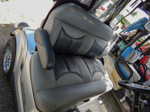 Padded bench front seat in Porsche golf cart