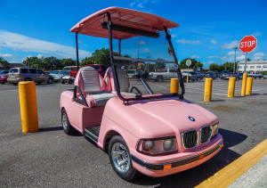 Pink BMW Club Car golf cart in Sun City Center, FL