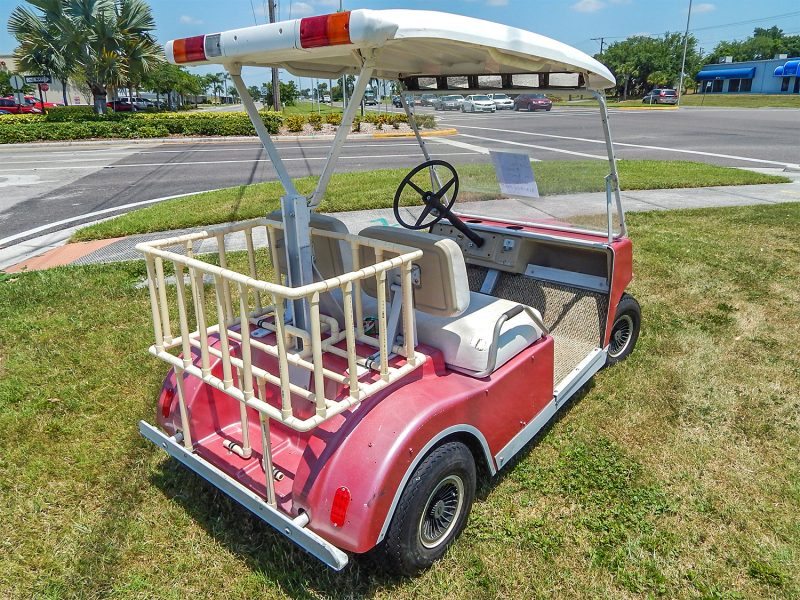 Rear view of pink Club Car golf cart $500 dollars, Sun City Center