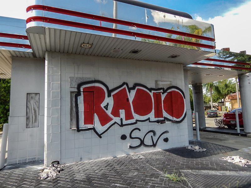 Tagged Radio SCV Graffiti art on closed down Checkers Hamburger in Sun City Center