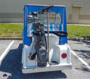 Tail lights and bag holder on white Royal Ride Rolls Royce golf cart