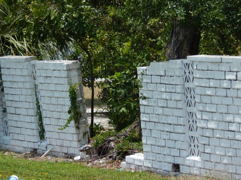 The brick wall falling down on S R 674 is private property in Sun City Center, FL