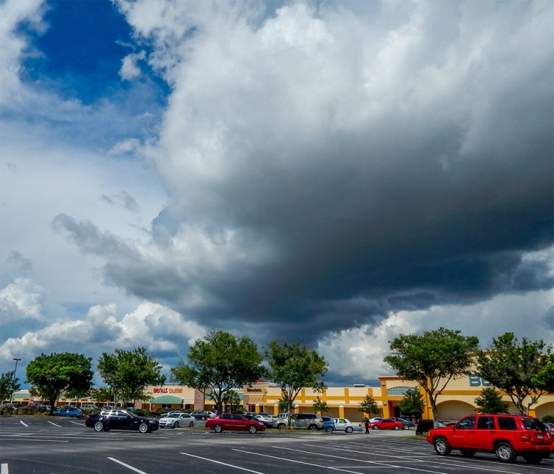 Thunderstorm clouds moving east over Cypress Village in Sun City Center FL
