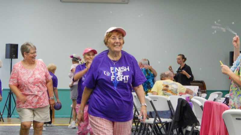 Volunteers walking for Relay For Life Cancer Benefit inside Sun City Center Chamber of Commerce