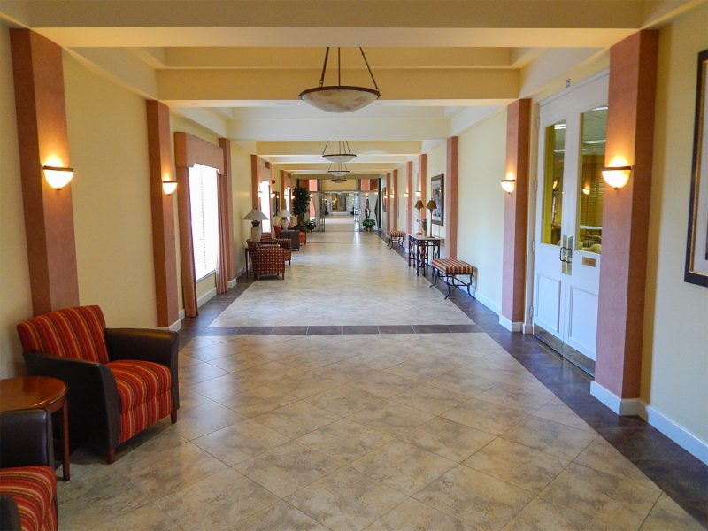 Wide hallways inside clubhouse used as walking track for retirees to exercise at Kings Point's Main Clubhouse