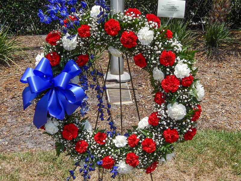 Red white and blue reef at base of flag from Sun City Center Funeral Home honors Memorial Day 2014