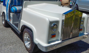 side of white Rolls Royce Royal Ride golf cart