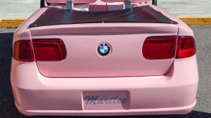 trunk and tail lights of pink BMW golf cart