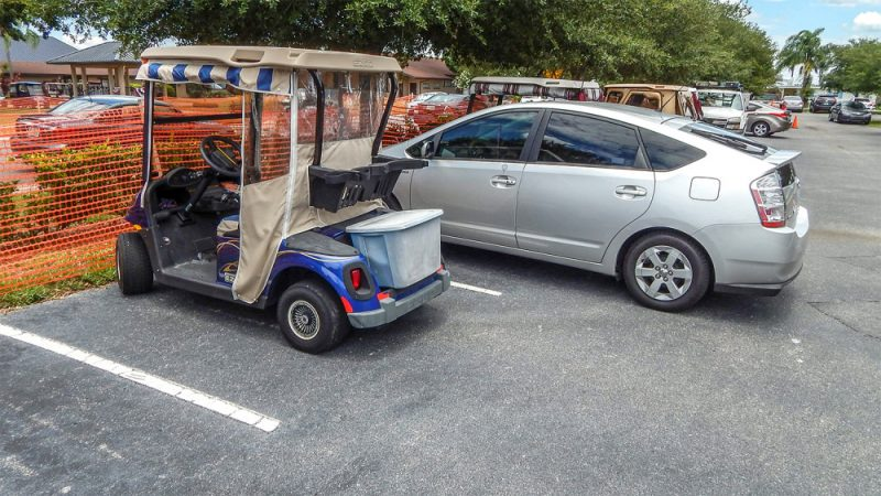 Car parked in golf cart space with the backend sticking out