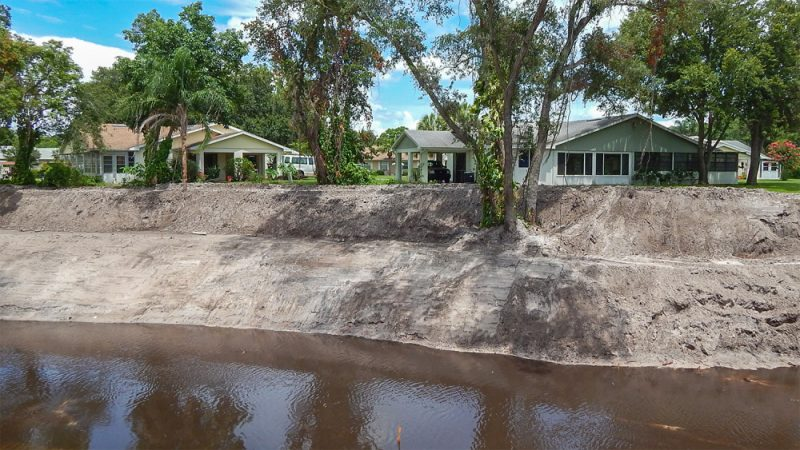 June 12, 2014: Excavator crews widen creek at Foxhunt and Kings Blvd in the Kings Point neighborhood of Sun City Center, FL