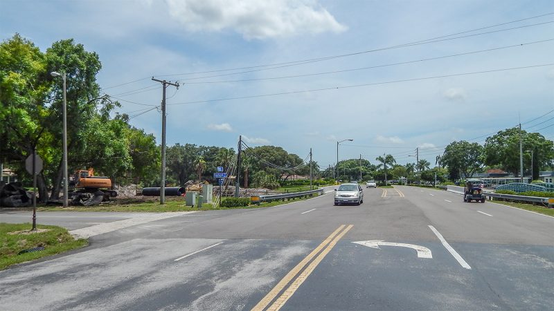 Kings Blvd in Kings Point with excavator on side of road, Sun City Center