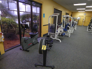 Rower and recumbent bike machines at South Clubhouse Fitness Center in Kings Point, Sun City Center, FL