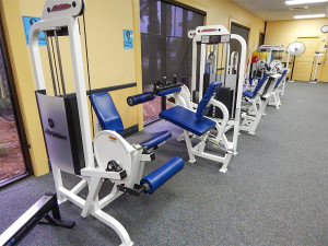 Seated leg raises and seated leg curl machines at South Club Fitness Center in Kings Point