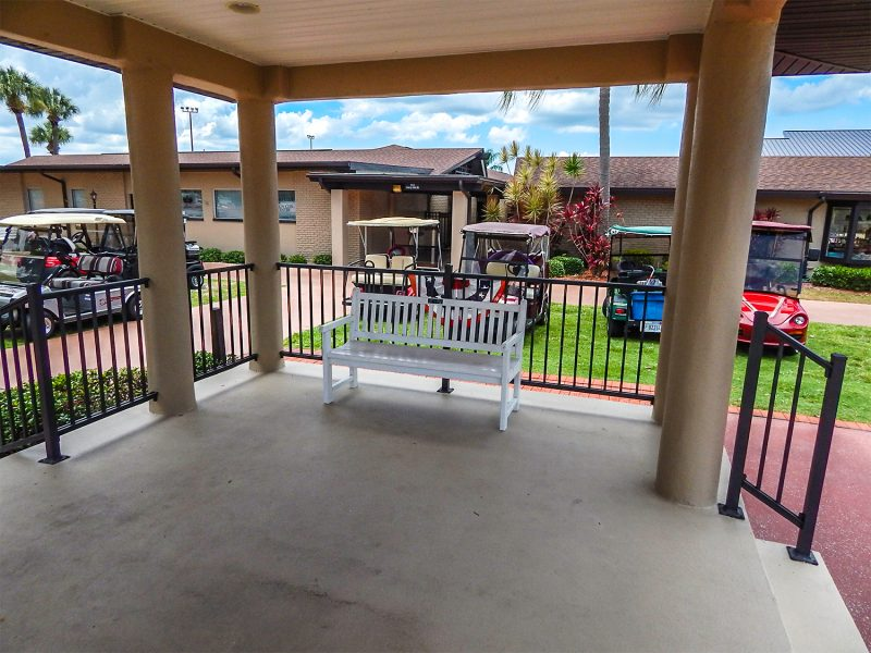 White bench under pavilion on Cherry Hills Drive made by Saw Dust Engineers in Sun City Center