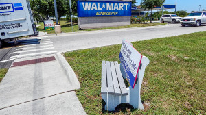 Sun City Center Cataract and Eye Clinic advertises on bench at Walmart in Wimauma, FL
