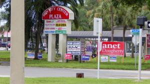 July 25, 2014- political campaign signs on intersection of Sun City Center Plaza and Rickenbacker Drive - Janet Dougherty, Rick Cockran, Robert Bauman, Robin Lester, Tim Schock, Laura Ward
