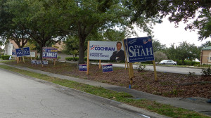 July 25, 2014 - 2014 political campaign signs next to Sun City Center Funeral Home - Dipa Shah, Karen Stanley, Dr Stacy White
