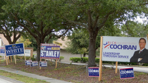 July 25, 2014 - political campaign signs by sidewalk next to Sun City Center Funeral Home - Karen Stanley, Dr Stacy White