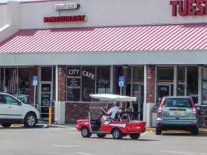 57 Chevy Bel Air golf cart driving by Sun City Center Cafe