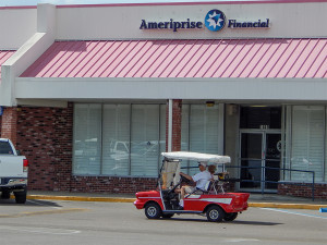 57 Chevy Bel Air golf cart passing Ameriprise Financial in Sun City Center Plaza