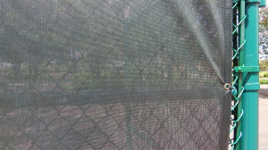 Aug 2, 2014 - New green mesh attached to fence on tennis courts at North Court Complex in Kings Point
