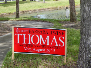 Aug 2, 2014 - Barbara Twine Thomas sign near Wood Stork by pond in Sun City Center
