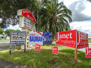 Aug 2, 2014 - Campaign signs by Sun City Center Plaza sign