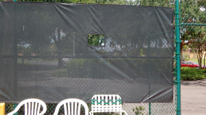 Aug 2, 2014 - Green mesh on fencing at tennis court at the North Court Complexe in Kings Point
