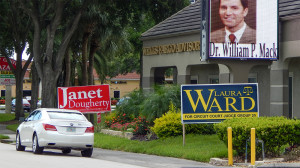 July 25, 2014 - Janet Dougherty and Laura Ward campaign signs of Wells Fargo, Sun City Center, FL