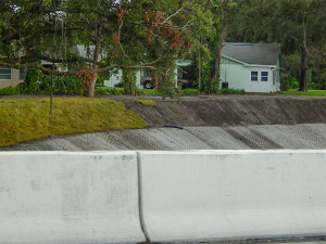 July 14, 2014: sod added to sides of creek that runs under Kings Blvd in Kings Point, SCC, FL