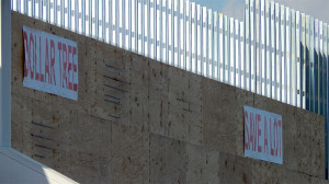 July 18, 2014 - plywood attached to 2x4 aluminum planks on front of Save A Lot in Sun City Center Plaza