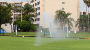 July 20, 2014 - power sprinkler sprays water on Lawn Bowling greens in Kings Point with Sun Towers in background