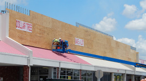 July 22, 2014 - construction men on lift working on Dollar Tree and Save A Lot facade at Sun City Center Plaza